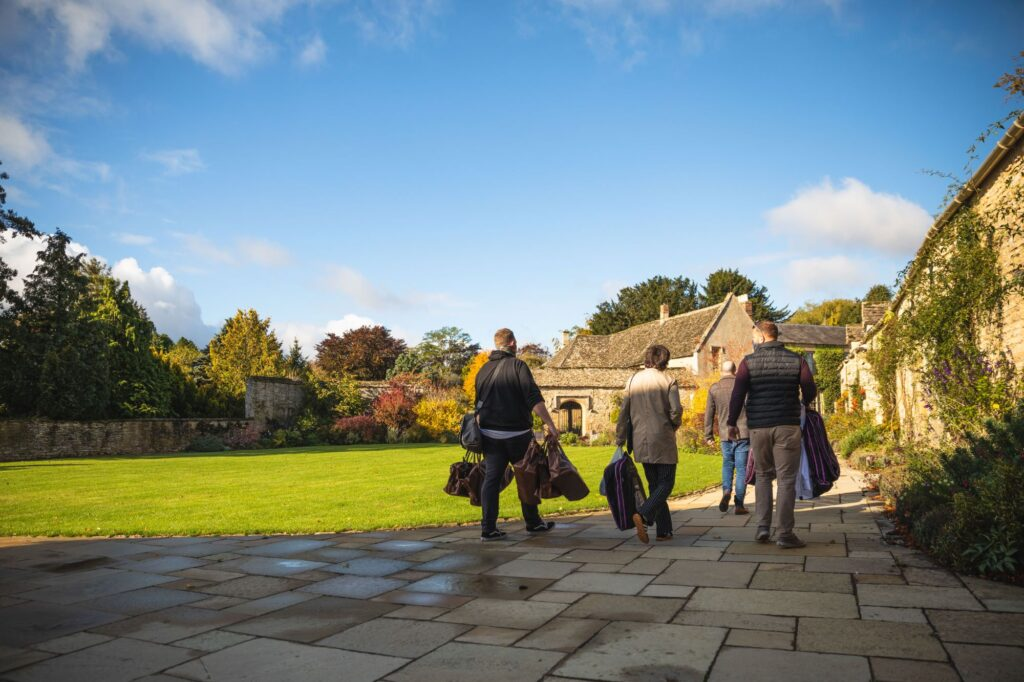 groomsmen carry bags groom prep caswell house venue oxfordshire wedding photography