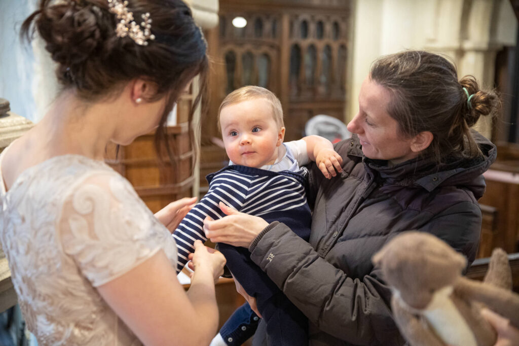 brides baby gets attention st nicholas church micro wedding old marston villlage oxford wedding photographers