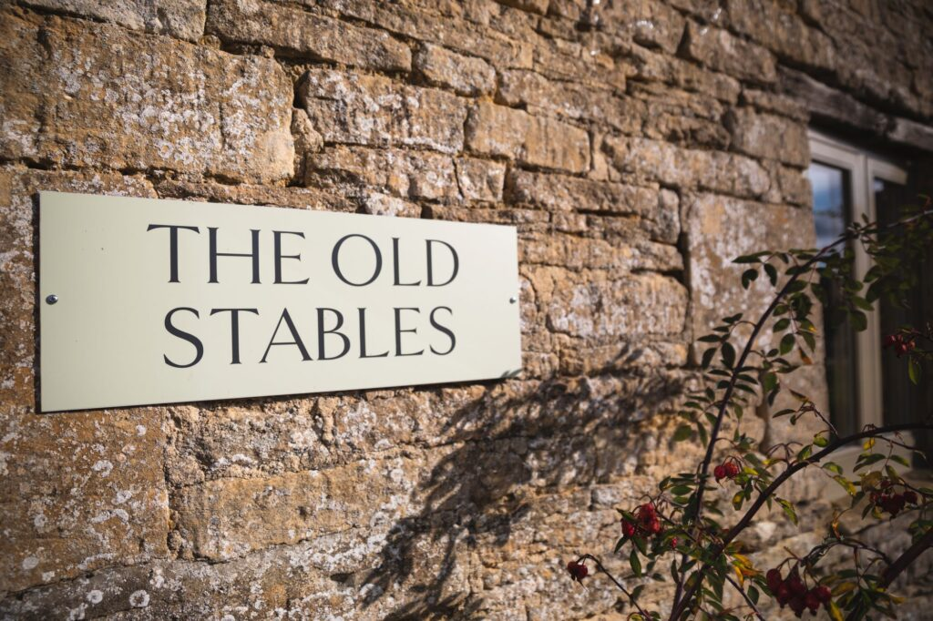 the stables sign caswell house venue oxford wedding photographer