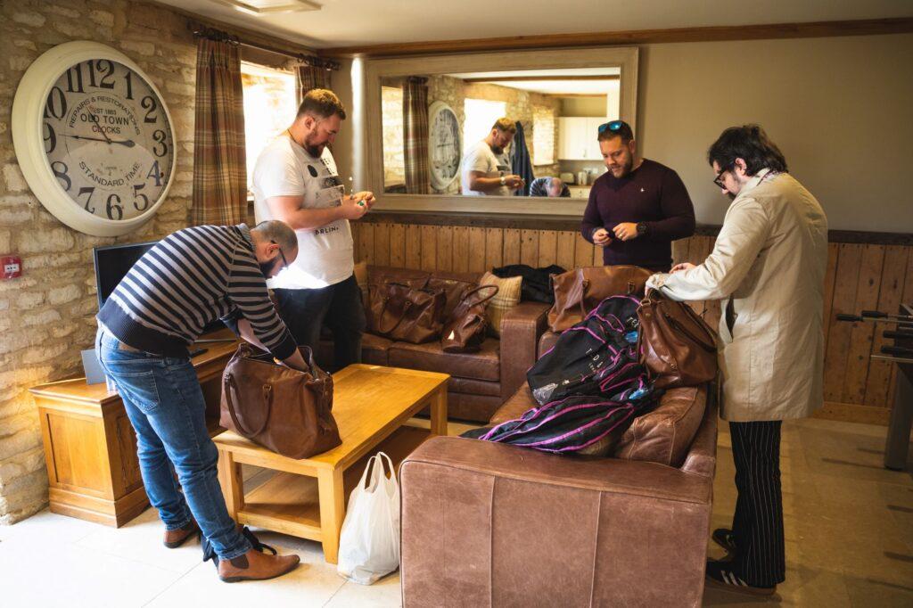 groomsmen unpack groom preparation caswell house venue oxford wedding photography