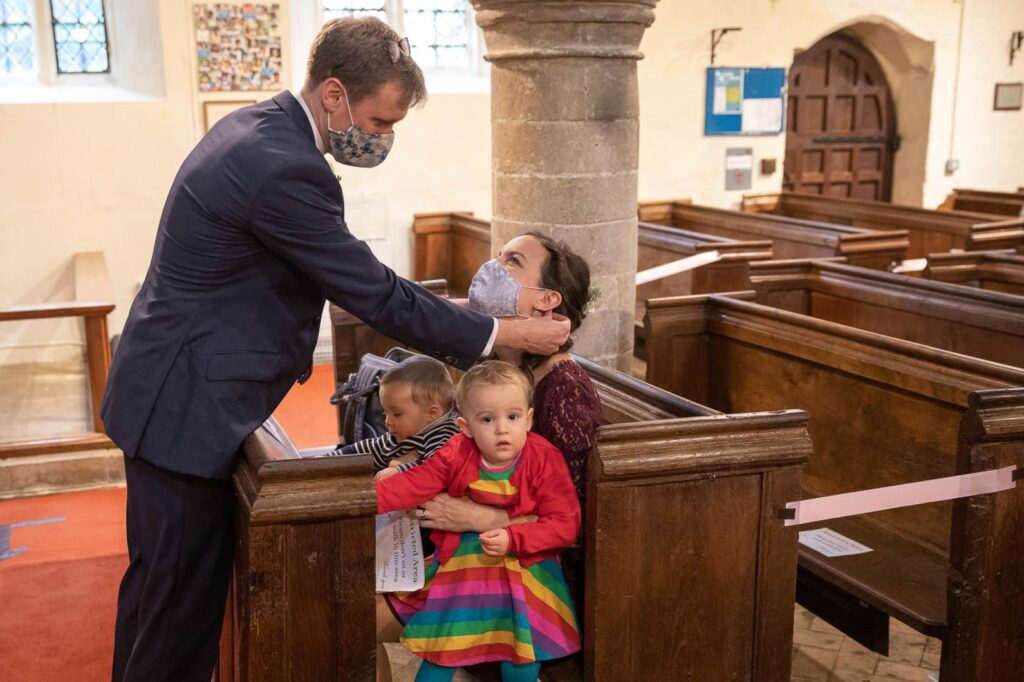 micro wedding guests don covid masks st nicholas church micro wedding old marston oxfordshire wedding photographer