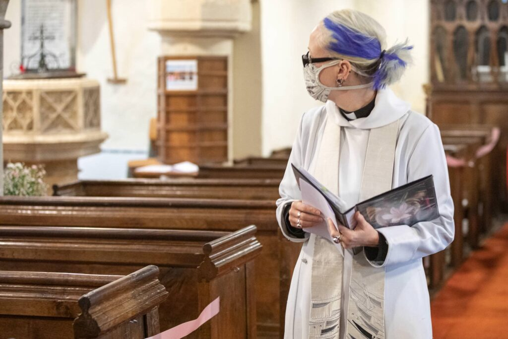 vicar wears covid mask st nicholas church micro wedding old marston oxfordshire wedding photography