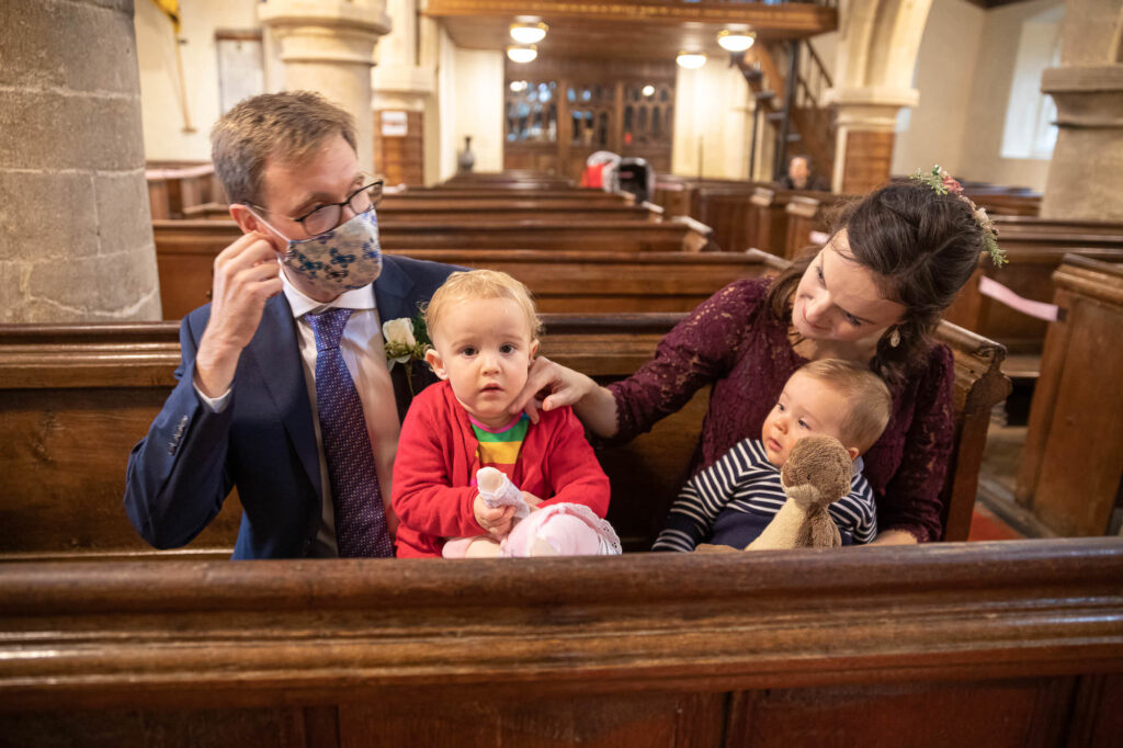 two guests and toddlers attend micro wedding st nicholas church old marston oxford wedding photographer