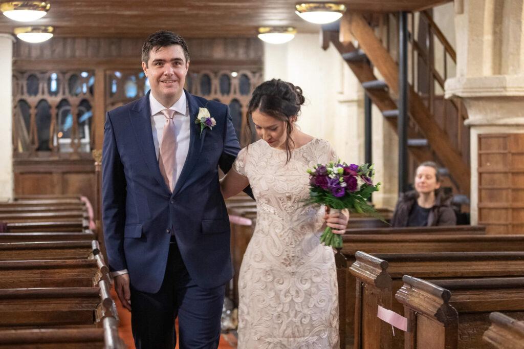 bride groom approach vicar st nicholas church micro wedding marston oxford wedding photographers