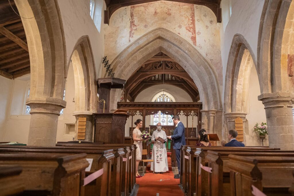 bride groom exchange vows micro wedding st nicholas church old marston oxfordshire wedding photographer