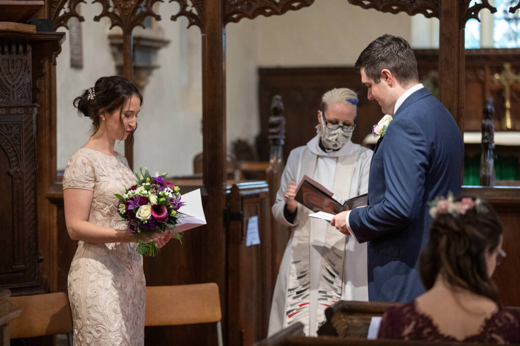 masked vicar conducts micro wedding ceremony st nicholas church old marston oxfordshire wedding photography