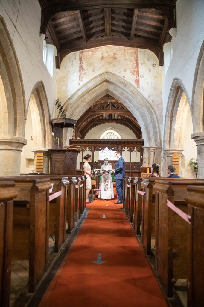 vicar conducts covid marriage ceremony st nicholas church old marston village oxfordshire wedding photographer
