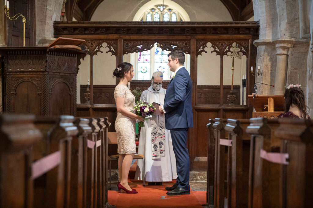bride groom exchange vows micro wedding ceremony st nicholas church old marston oxfordshire wedding photographers