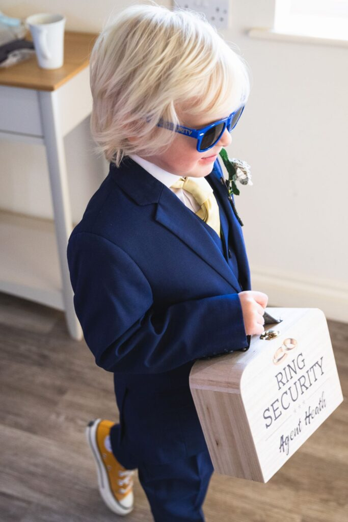pageboy carries ring security box bridal prep caswell house venue oxford wedding photography