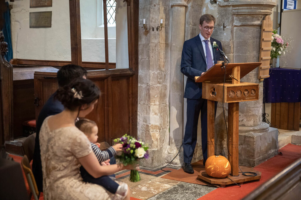 guest reads service micro wedding ceremony st nicholas church old marston oxford wedding photographer