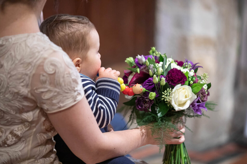 bride baby bouquet micro wedding ceremony st nicholas church oxford wedding photographers