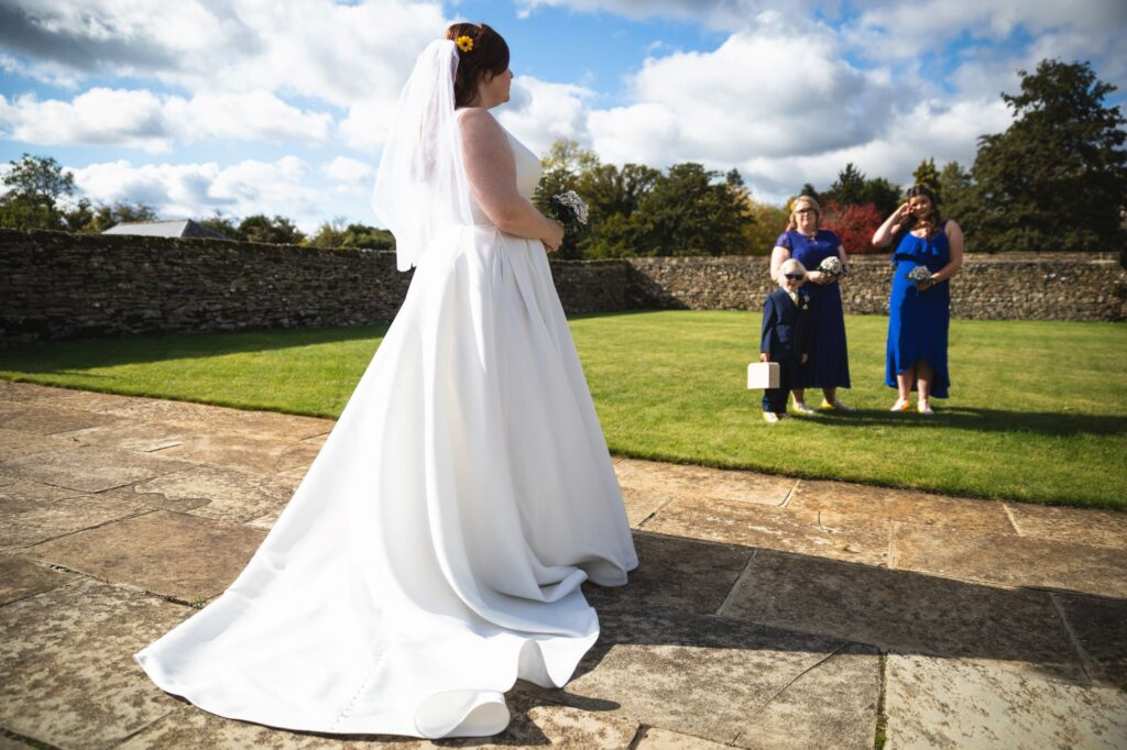 bridesmaids pageboy first look brides dress caswell house venue oxford wedding photography
