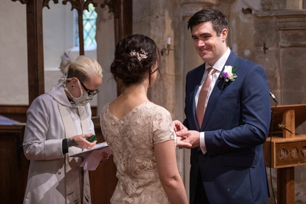 bride groom exchange rings micro wedding ceremony st nicholas church oxfordshire wedding photography