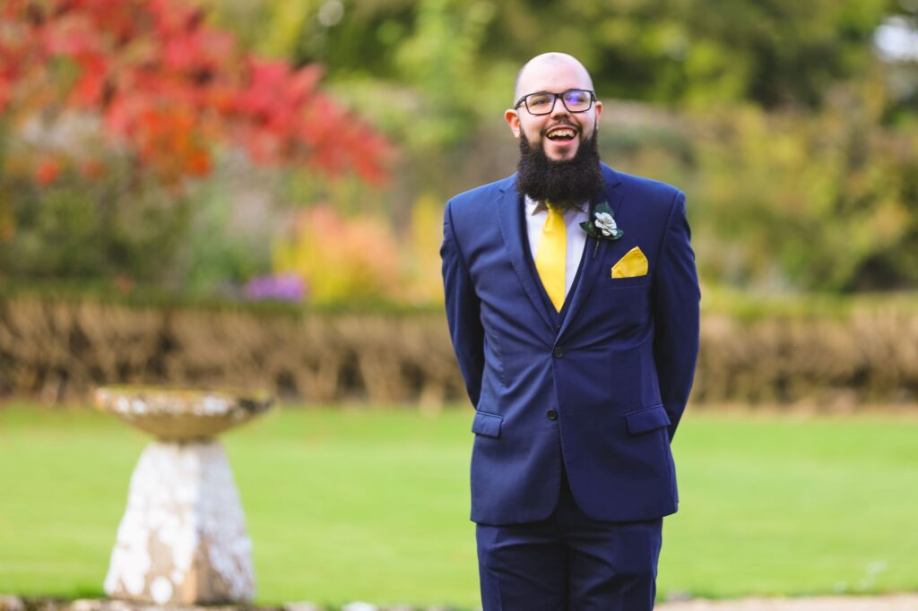 grooms first look at brides dress caswell house gardens oxfordshire wedding photographers