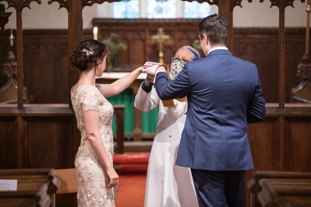vicar blesses rings covid marriage ceremony st nicholas church oxford wedding photographer