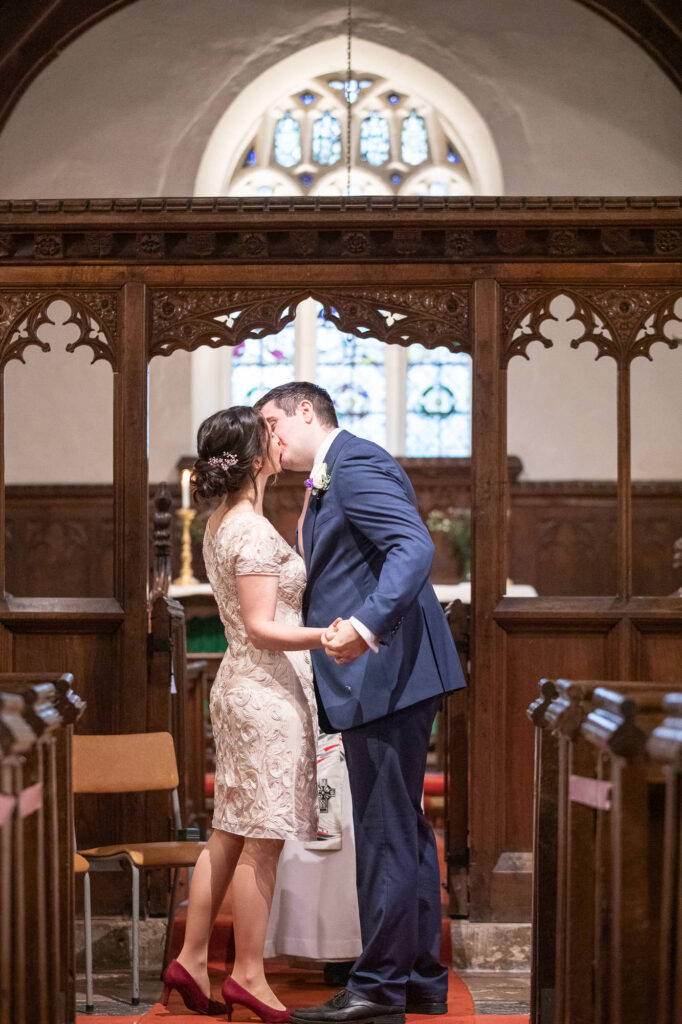 bride groom first kiss covid marriage ceremony st nicholas church oxford wedding photographers