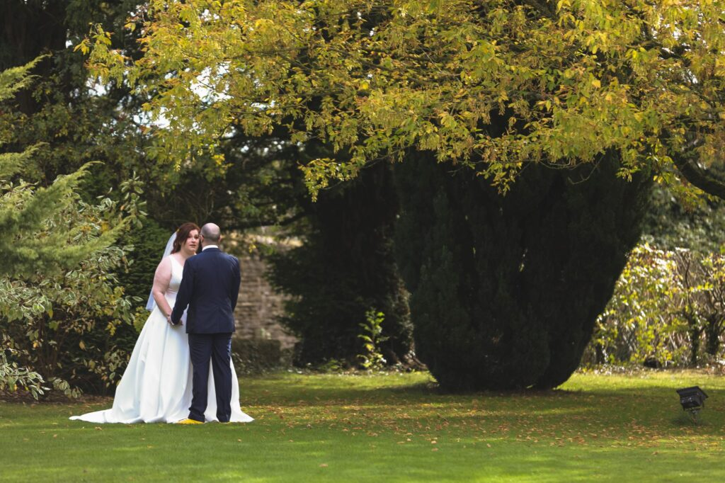 bride grooms romantic moment caswell house gardens oxfordshire wedding photographer