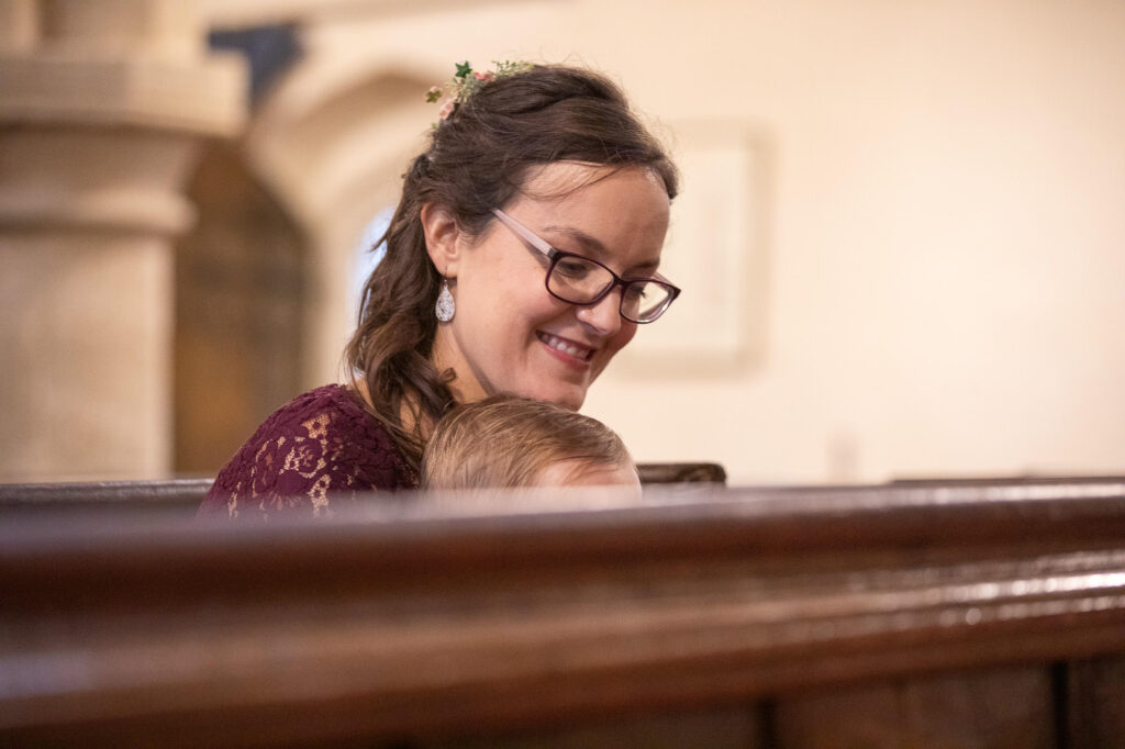 smiling guest hears covid marriage ceremony st nicholas church oxfordshire wedding photography