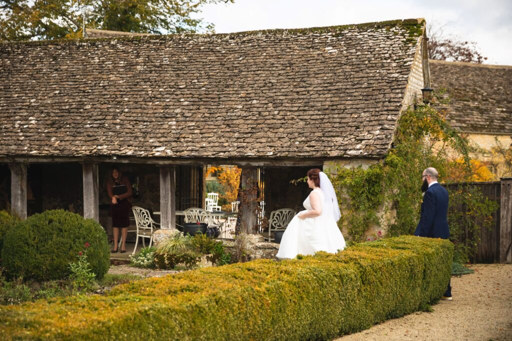 bride groom check outside wedding area caswell house venue oxfordshire wedding photographers