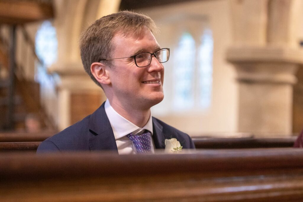 smiling guest covid marriage ceremony st nicholas church, marston oxford wedding photographer