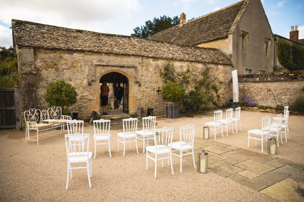 outside marriage ceremony area caswell house venue oxfordshire wedding photography
