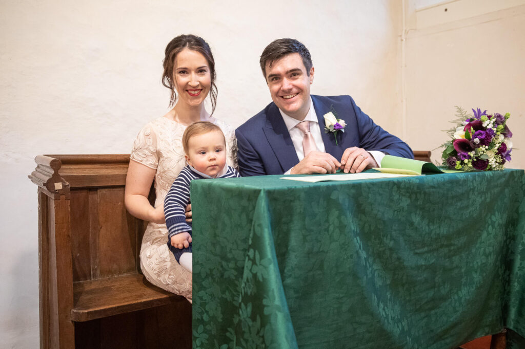 bride groom baby marriage register signing ceremony st nicholas church oxford wedding photography