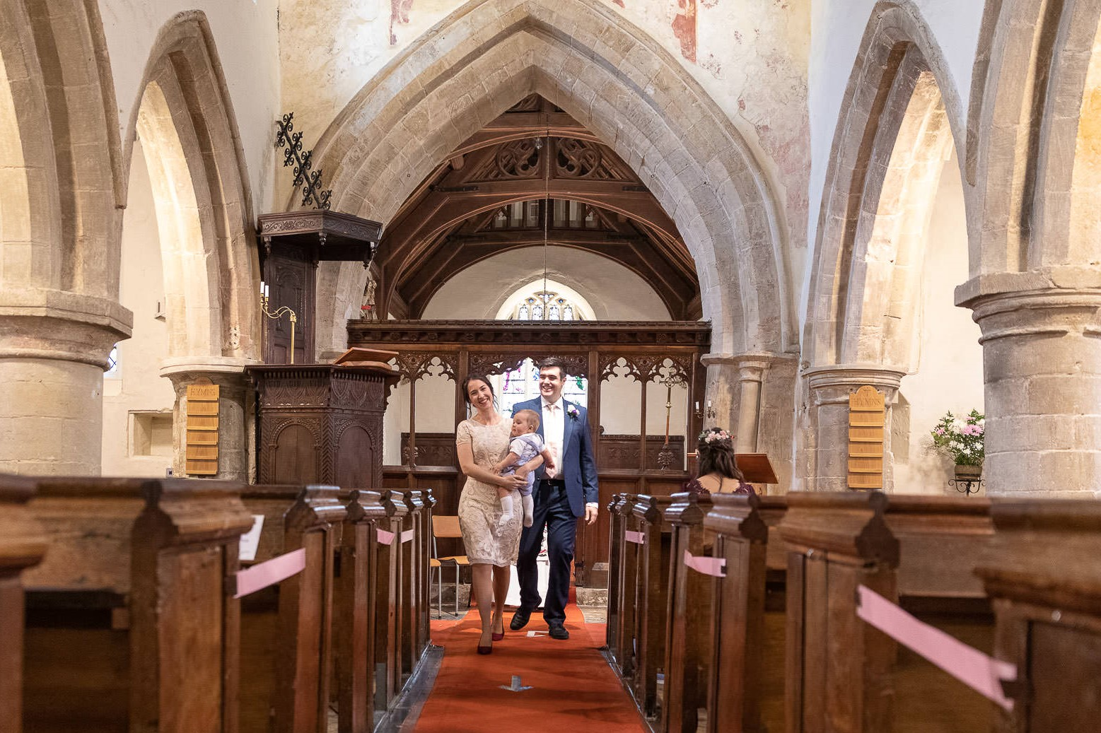 groom bride holding baby aisle walk covid marriage ceremony st nicholas church oxfordshire wedding photography