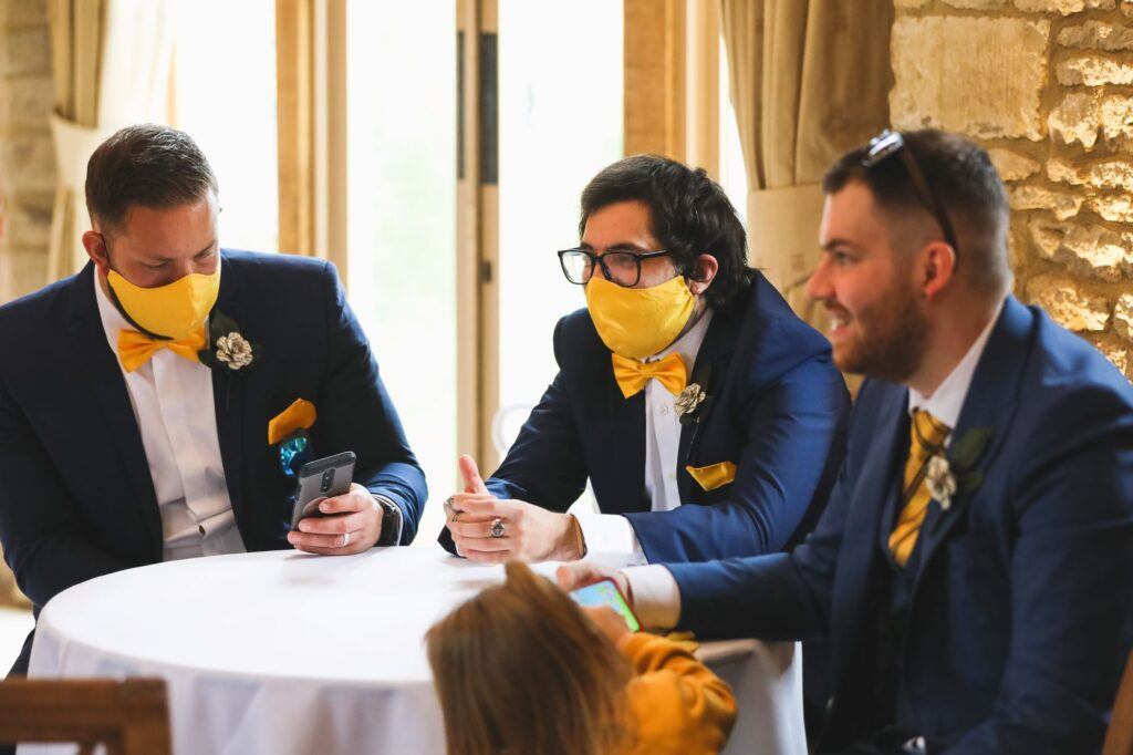 groomsmen wait marriage ceremony caswell house venue oxfordshire wedding photographers