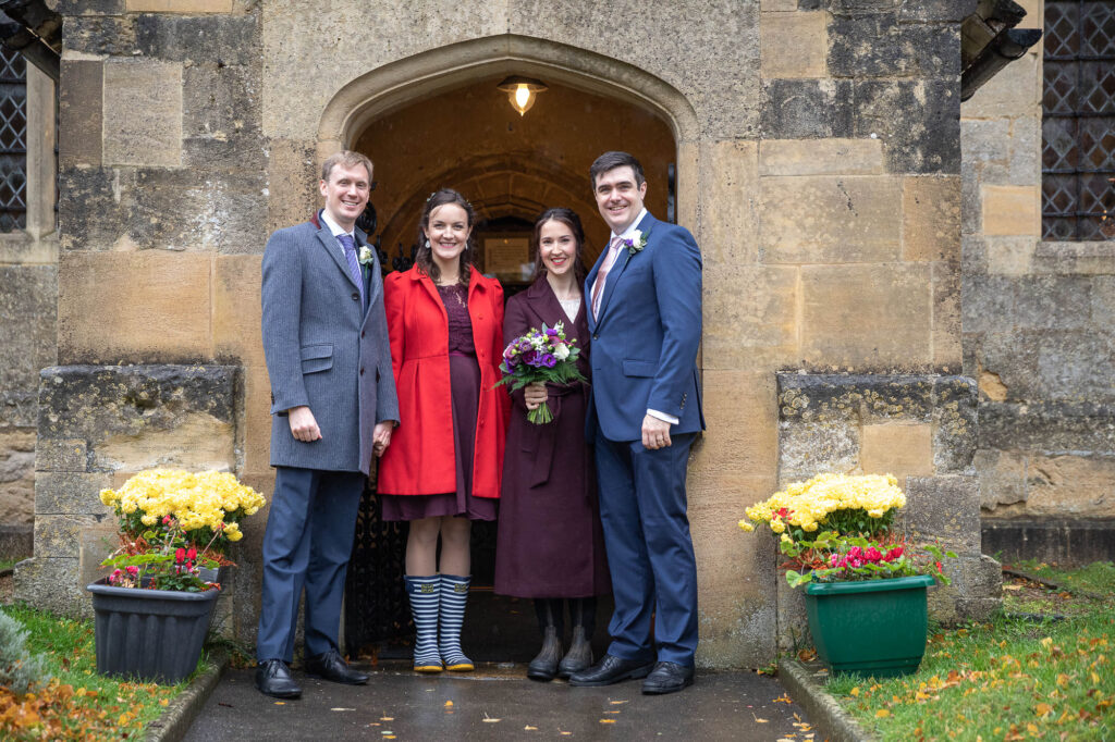 bride groom two guests formal portrait covid marriage ceremony st nicholas church oxford wedding photographers