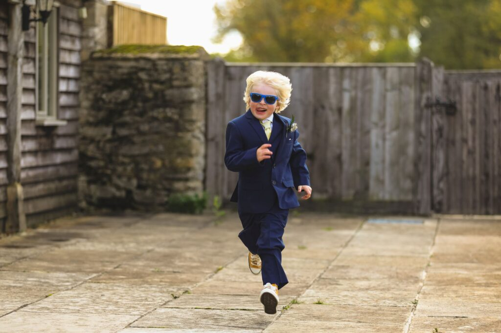 running pageboy caswell house venue oxfordshire wedding photography