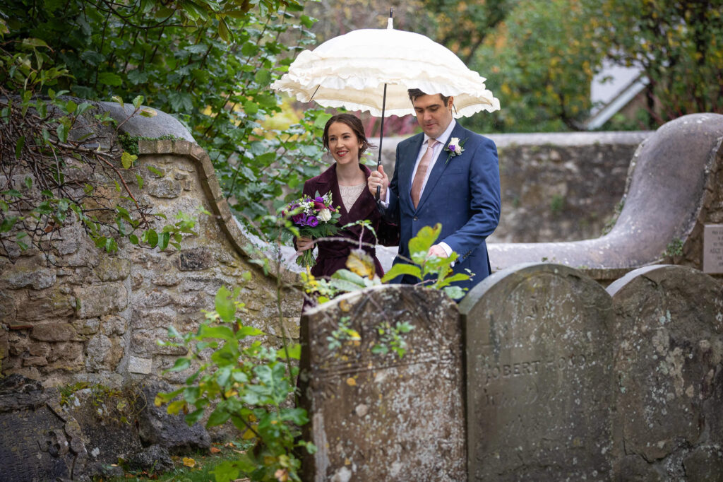 bride groom stroll churchyard st nicholas church oxford wedding photography