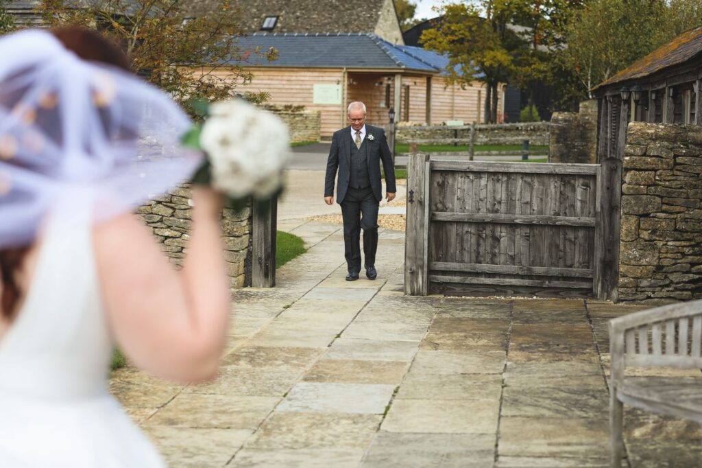 father of bride walking to meet bride caswell house venue oxfordshire wedding photographer