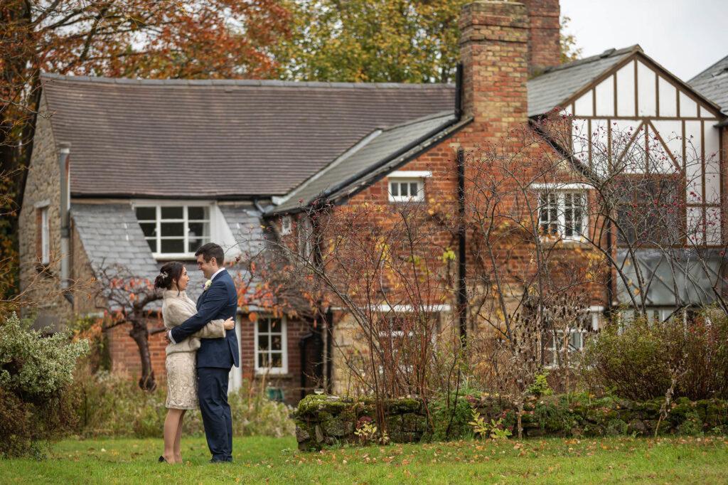 bride groom embrace orchard cottage garden old marston village oxfordshire wedding photography
