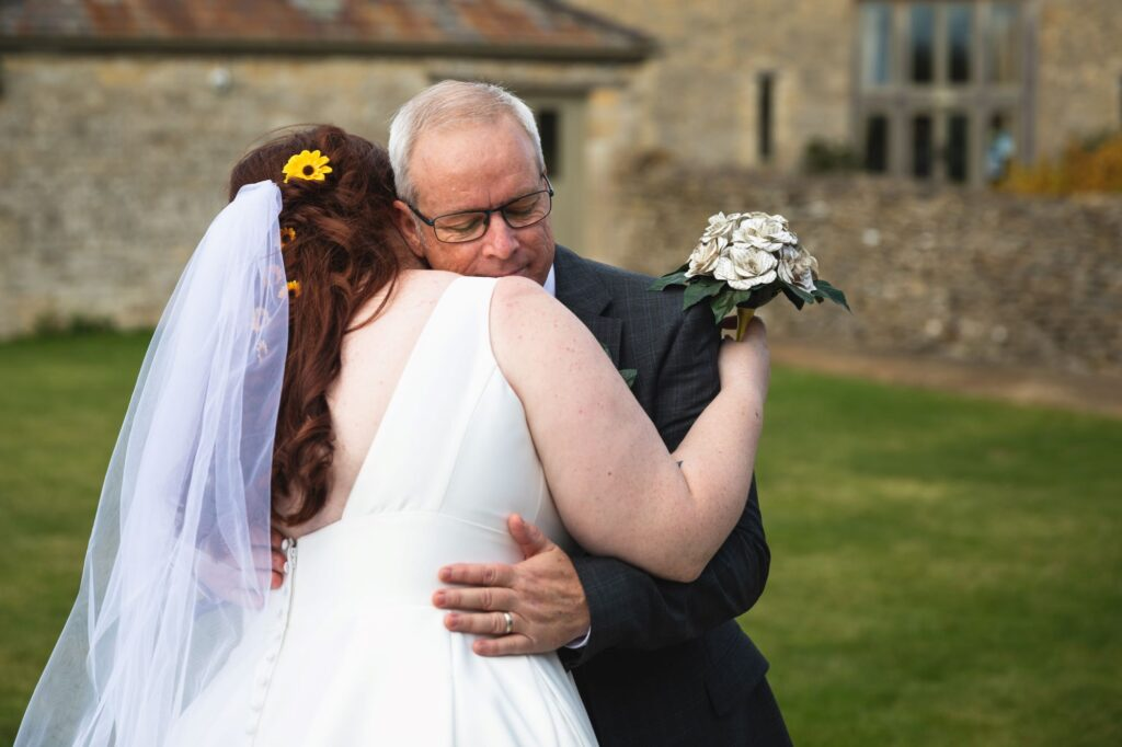bride hugs father caswell house venue oxford wedding photographer