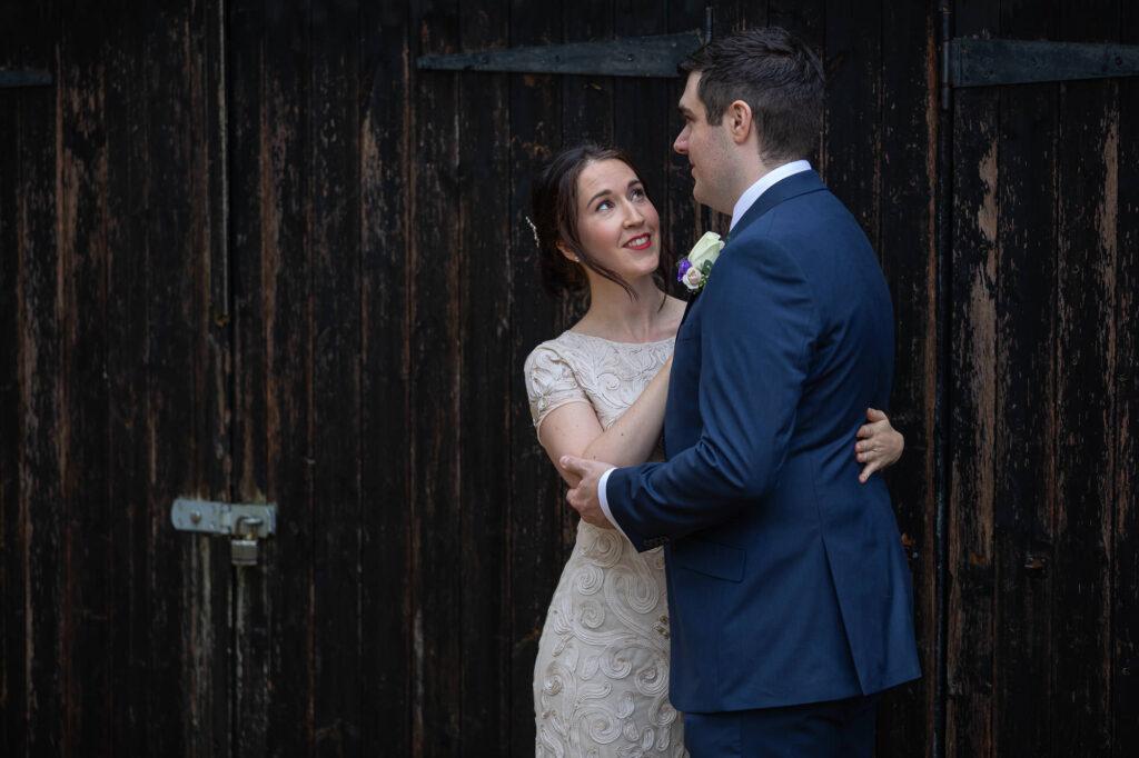 bride grooms romantic moment orchard garden old marston village oxfordshire wedding photographers