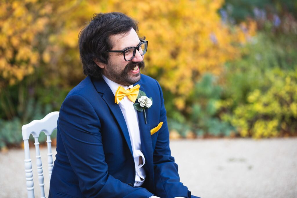 smiling groomsman outdoor ceremony caswell house venue oxford wedding photographer