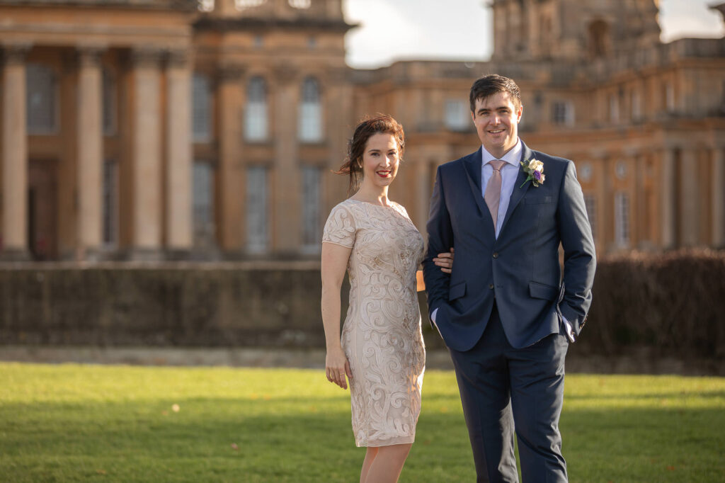 brides holds grooms arm blenheim palace grounds oxford wedding photographers