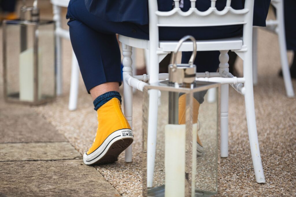 groomsmans yellow converse boots outdoor ceremony caswell house oxfordshire wedding photographer