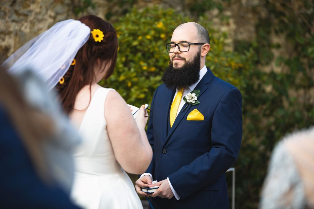 bride reads vows groom closes eyes caswell house ceremony oxford wedding photographer