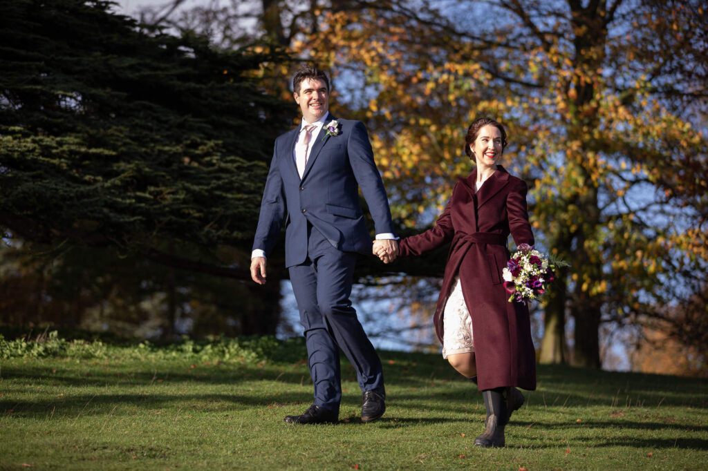 bride wears wellies holds grooms hand blenheim palace grounds walk oxfordshire wedding photographers