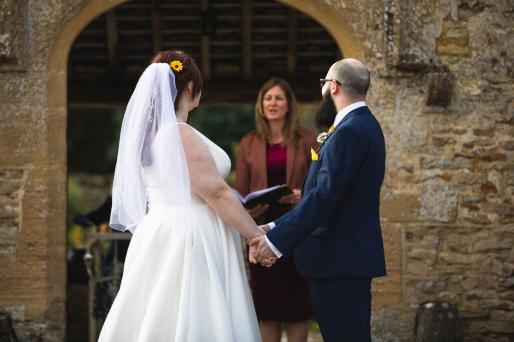 celebrant reads service outdoor ceremony caswell house venue oxford wedding photographers