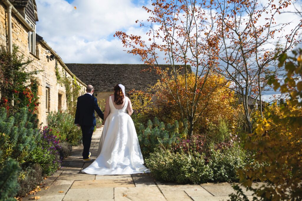 just married bride groom leave ceremony caswell house venue oxfordshire wedding photograher