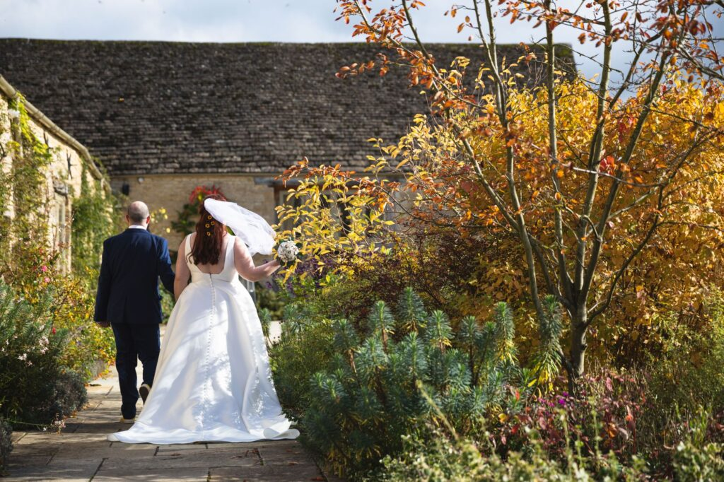bride groom hold hands caswell house gardens oxfordshire wedding photographers