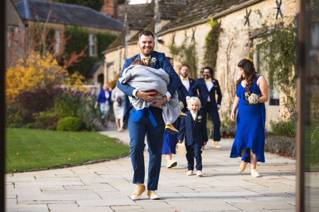 guests leave outdoor marriage ceremony caswell house venue oxford wedding photographer