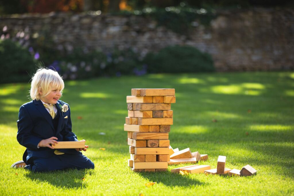 pageboy plays outdoor game caswell house venue oxford wedding photography