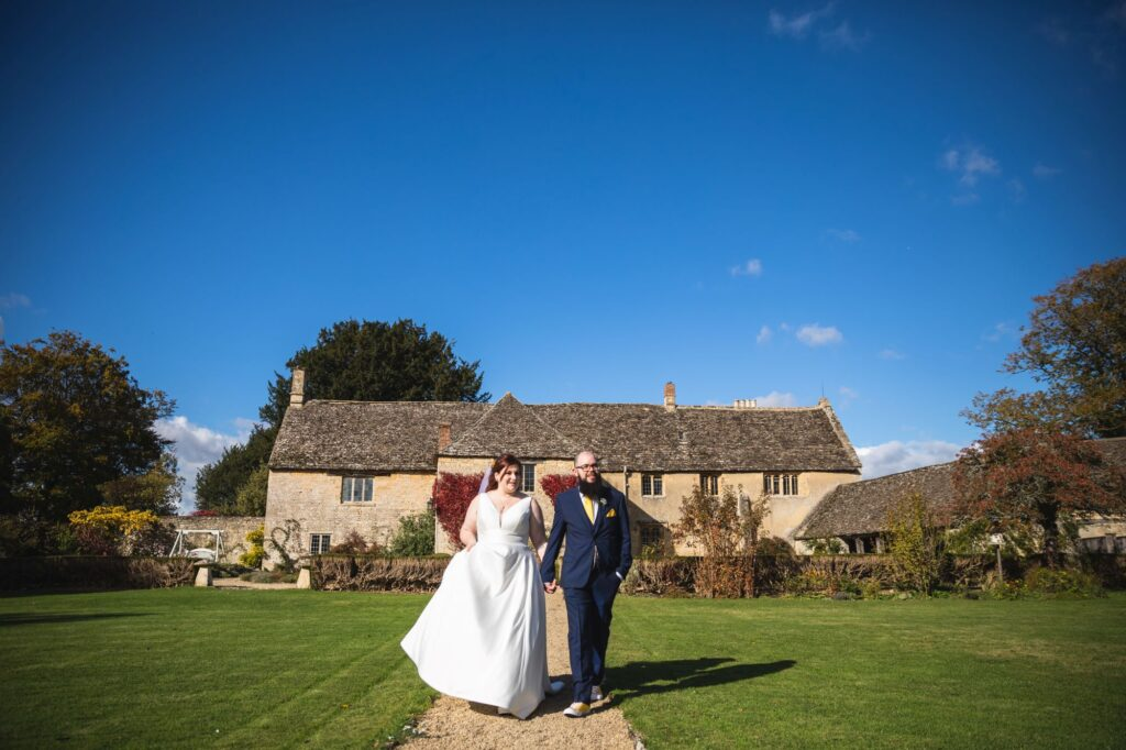 bride groom stroll caswell house grounds oxfordshire wedding photographer