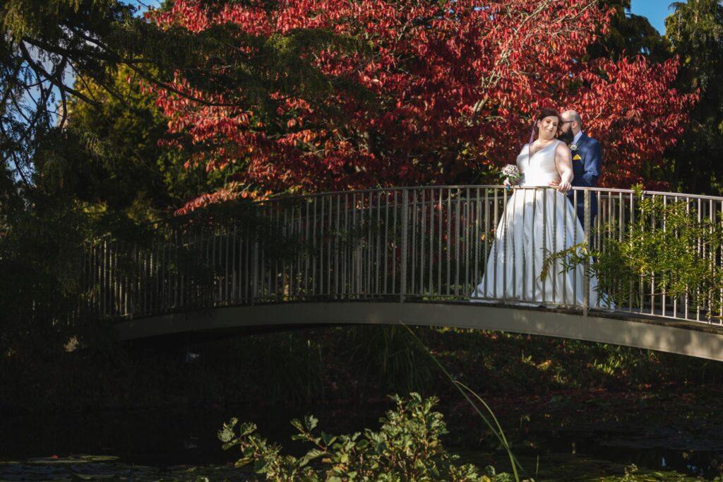 bride groom on garden bridge caswell house venue oxfordshire wedding photographers