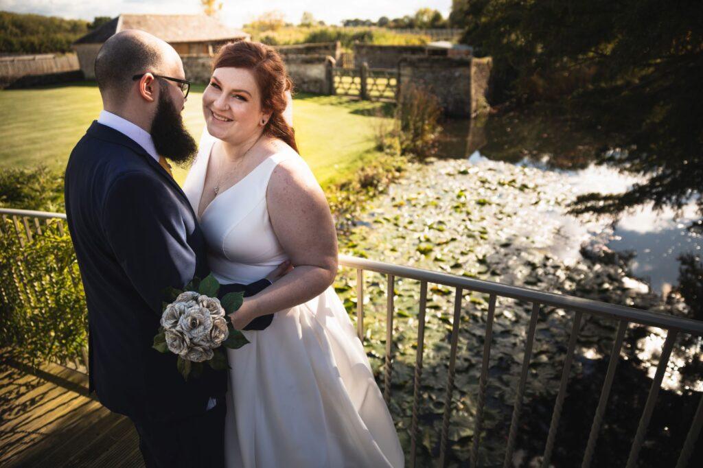 smiling bride groom on caswell house garden bridge oxfordshire wedding photography
