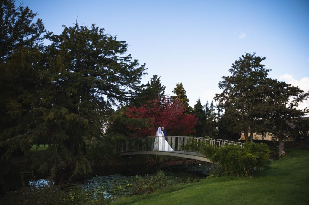 bride groom evening stroll caswell house garden bridge oxford wedding photographer