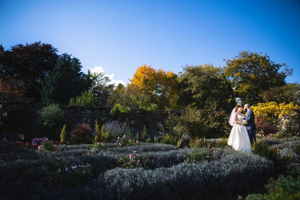 bride grooms romantic moment caswell house cottage gardens oxfordshire wedding photographer